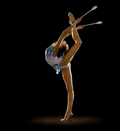 Girl engaged art gymnastics isolated photo
