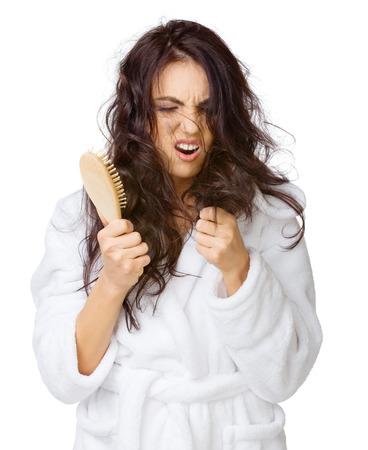cabello rizado: Enfadado chica con el pelo enredado aislado Foto de archivo