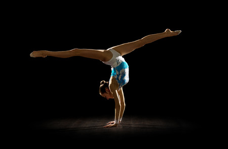Girl engaged art gymnastic isolated