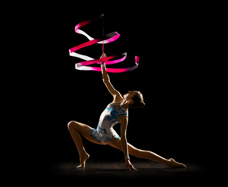 gymnastics silhouette: Young girl engaged art gymnastic isolated