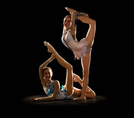 gymnastics silhouette: Young girls engaged art gymnastic isolated