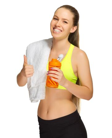 only one girl: Sporty girl with towel and bottle isolated