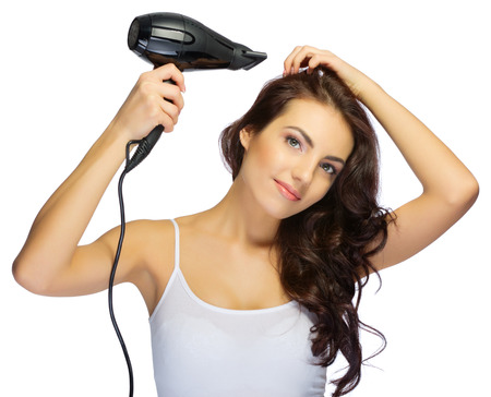 Young healthy girl with hair dryer isolated Stock Photo