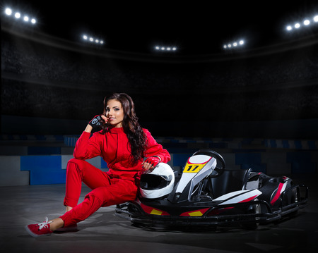 kart: Young girl racer with kart at stadium