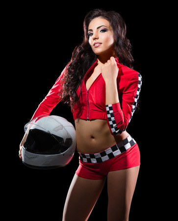 sports race: Young girl racer with helmet isolated Stock Photo