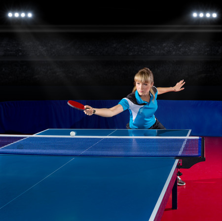 tennis net: Young girl table tennis player at sports hall Stock Photo