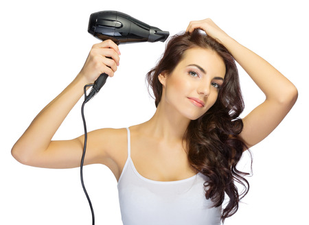 hair treatment: Young girl with hair dryer isolated