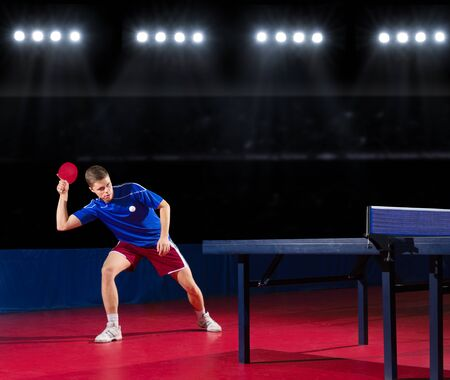 table tennis: Young table tennis player at sports hall Stock Photo