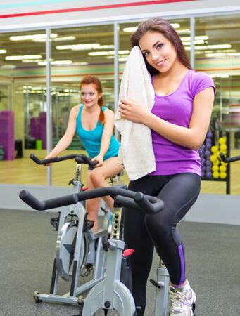 finishing: Two young girls at fitness club