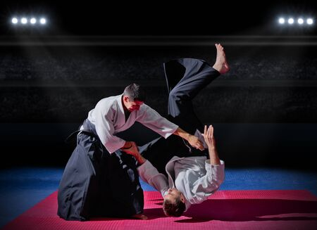 fighting arts: Fight between two martial arts fighters at sports hall Stock Photo