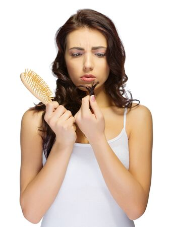 frizzy hair: Young girl with hairbrush isolated