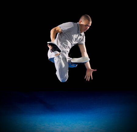 breakdancer: Breakdancer training on dark background Stock Photo