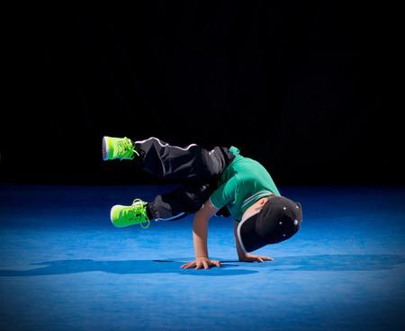 Little boy breakdancer on black Stock Photo