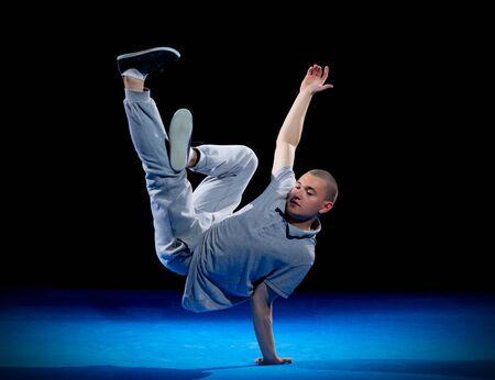 Break dancer training on black Stock Photo
