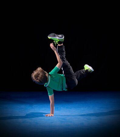 breakdancer: Little boy breakdancer on black Stock Photo