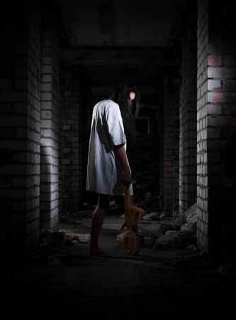 young girl barefoot: Scary zombie girl in old house