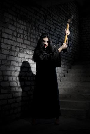 axe girl: Zombie girl in old house Stock Photo