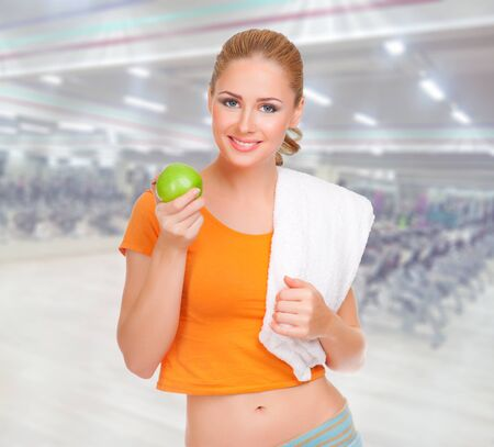 healthy snack: Young sporty woman at fitness club Stock Photo