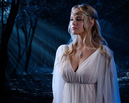 nude young woman: Young elven girl in night forest