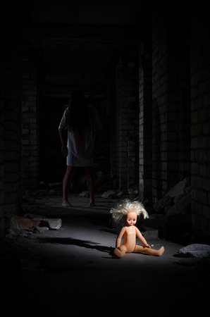 young girl barefoot: Zombie girl in the ancient house