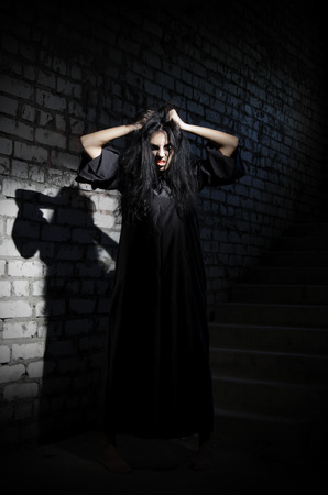 young girl barefoot: Zombie girl in old house Stock Photo