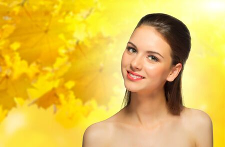 beautiful blonde woman: Young healthy girl on autumnal background
