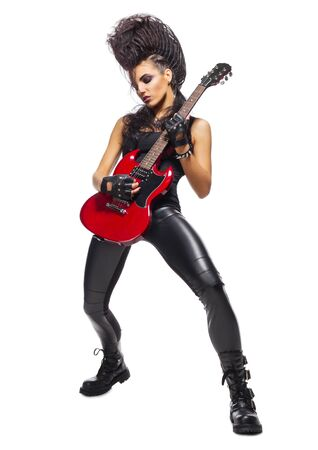 heavy metal: Rock musician with guitar isolated