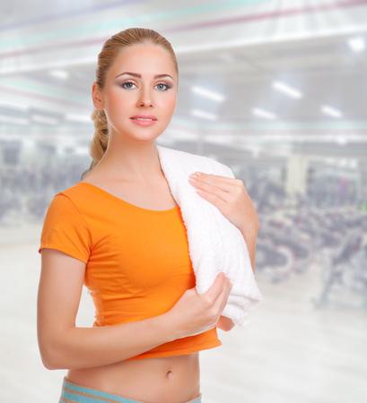 Sporty woman in fitness club