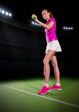 20 29 years: Young woman tennis player on stadium Stock Photo