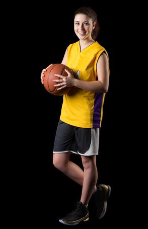 20 29: Young girl basketball player isolated