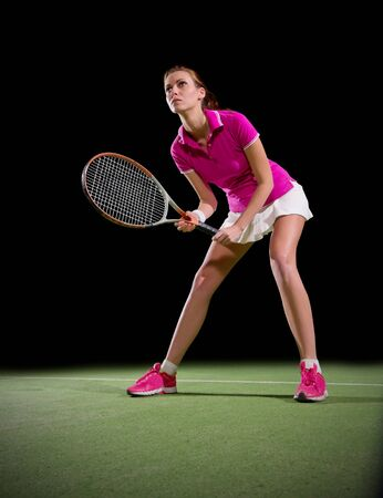 20 29: Young woman tennis player isolated Stock Photo