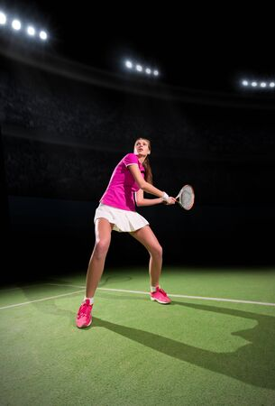 20 29: Young woman tennis player on court