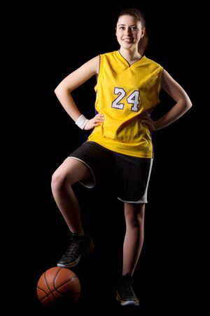 20 29 years: Young girl basketball player isolated