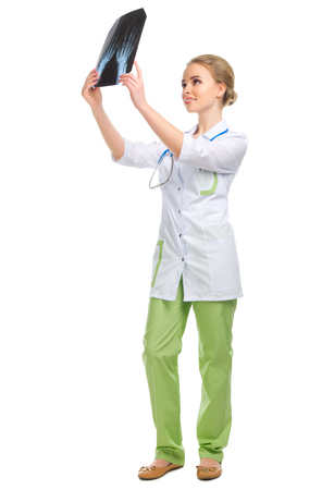 20 29: Young doctor with X-ray isolated on white Stock Photo