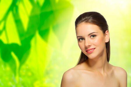 Young healthy girl on spring floral background Reklamní fotografie