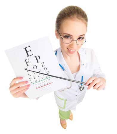 20 29: Young funny doctor with test table isolated on white