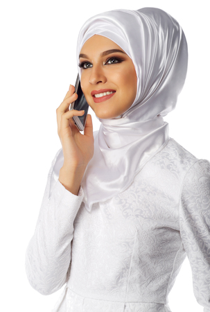 middle eastern woman: Muslim woman with phone isolated Stock Photo
