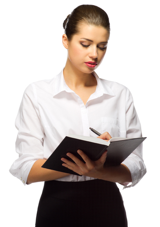 Young businesswoman with notebook isolated