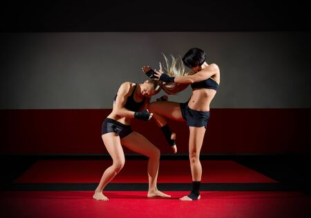 sports hall: Two kickboxers women in sports hall