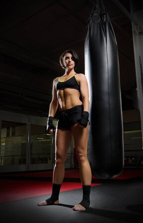 kickboxer: Kickboxer woman in sports hall