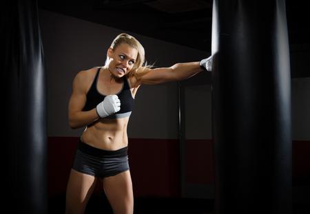 Training of kickboxer woman at gym Stock Photo