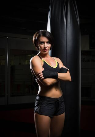 kickboxer: Young kickboxer woman at gym Stock Photo