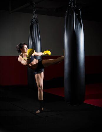 kickboxer: Training of kickboxer woman at sports hall