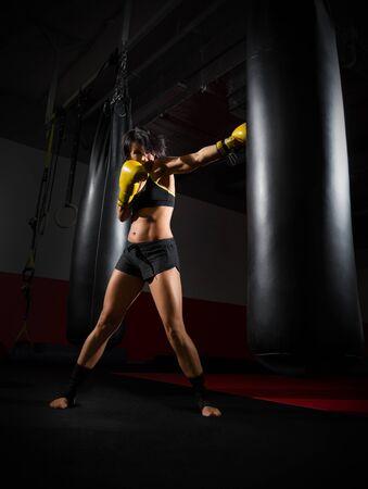 kickboxer: Training of kickboxer woman at gym Stock Photo