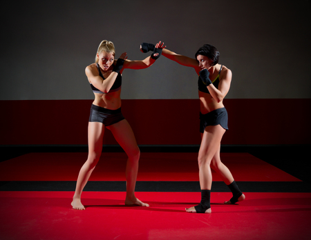 Two wrestler woman at gym Stock Photo