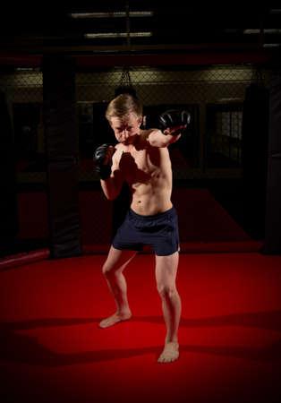 kickboxer: Young kickboxer training at gym Stock Photo