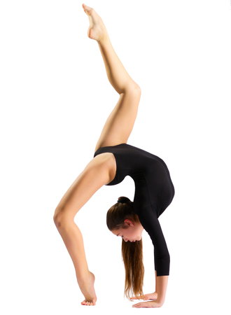 Young girl doing gymnastic exercises isolated Stock Photo