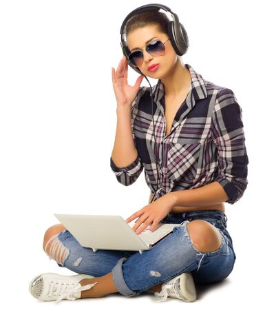 listen music: Young girl listen music isolated Stock Photo