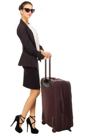 business traveller: Young traveling businesswoman isolated on white