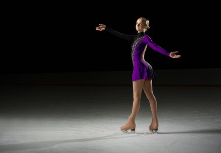 ice arena: Young girl figure skater (on ice arena ver)